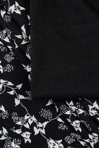 Dzianina dresowa pętelka czarna w białe listki - 185cm 320g/m2 thumbnail