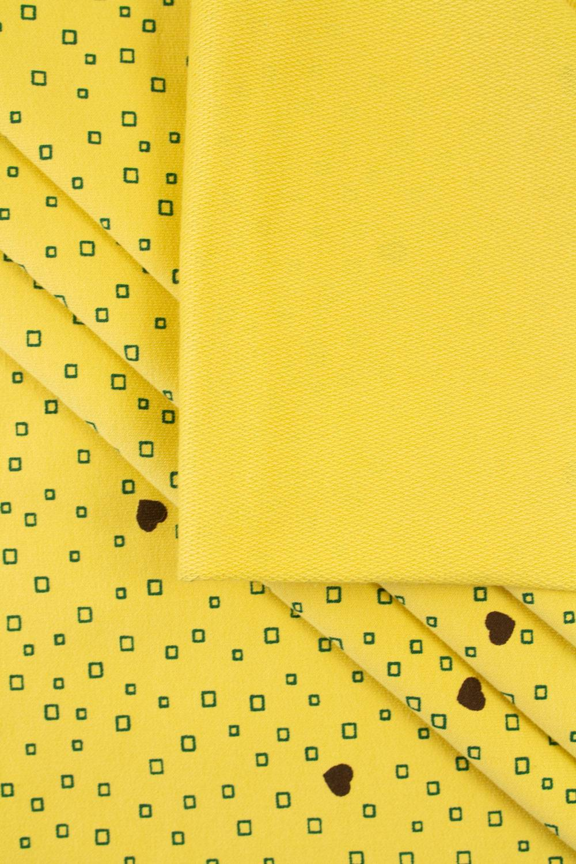 Dzianina dresowa pętelka żółta z nadrukiem serduszka/kwadraciki - 180cm 240g/m2