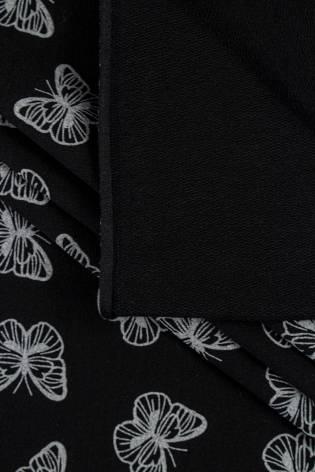Dzianina dresowa pętelka czarna w białe motylki - 185cm 260g/m2 thumbnail