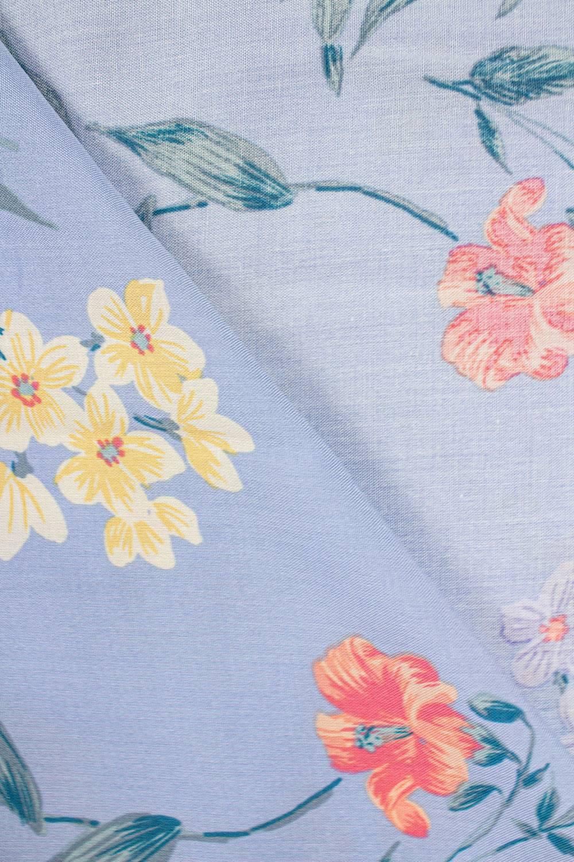 Tkanina wiskozowa - błękitna w kolorowe kwiaty -  140cm 130g/m2